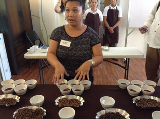 Kat Mulingtapang, a Filipina Q Grader from San Francisco, demonstrates how to do coffee cupping.